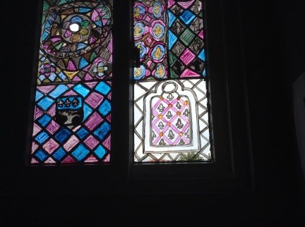 Window with the red lines with diamonds in the middle for fleur-de-lys design