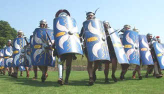 Legionnaires with blue shields march