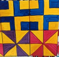 Purple and yellow and red and yellow right triangle patterns (below)/ blue and yellow cross-overs (above)