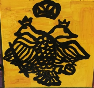 Komnenos family double-headed eagle in a yellow background