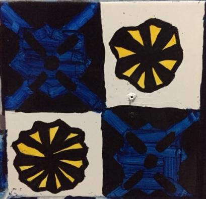Alternating blue diamonds and black/ yellow decagons pattern