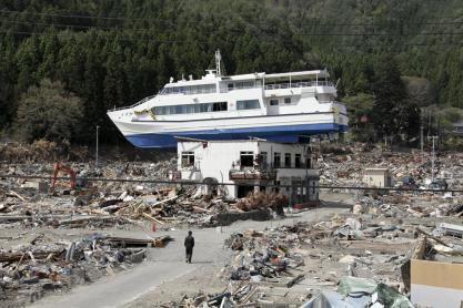 Ship carried above a building in a modern day tsunami