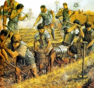 Legionnaires dig trenches to build a camp
