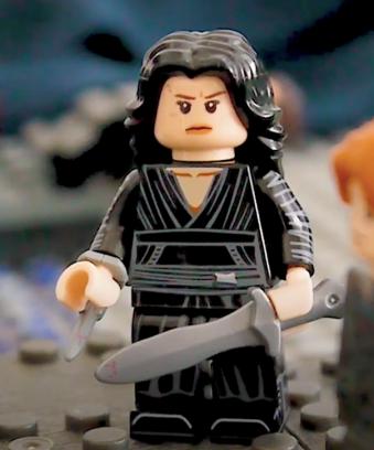 Lego figure of Giulia in black dress, dagger, and hidden blade