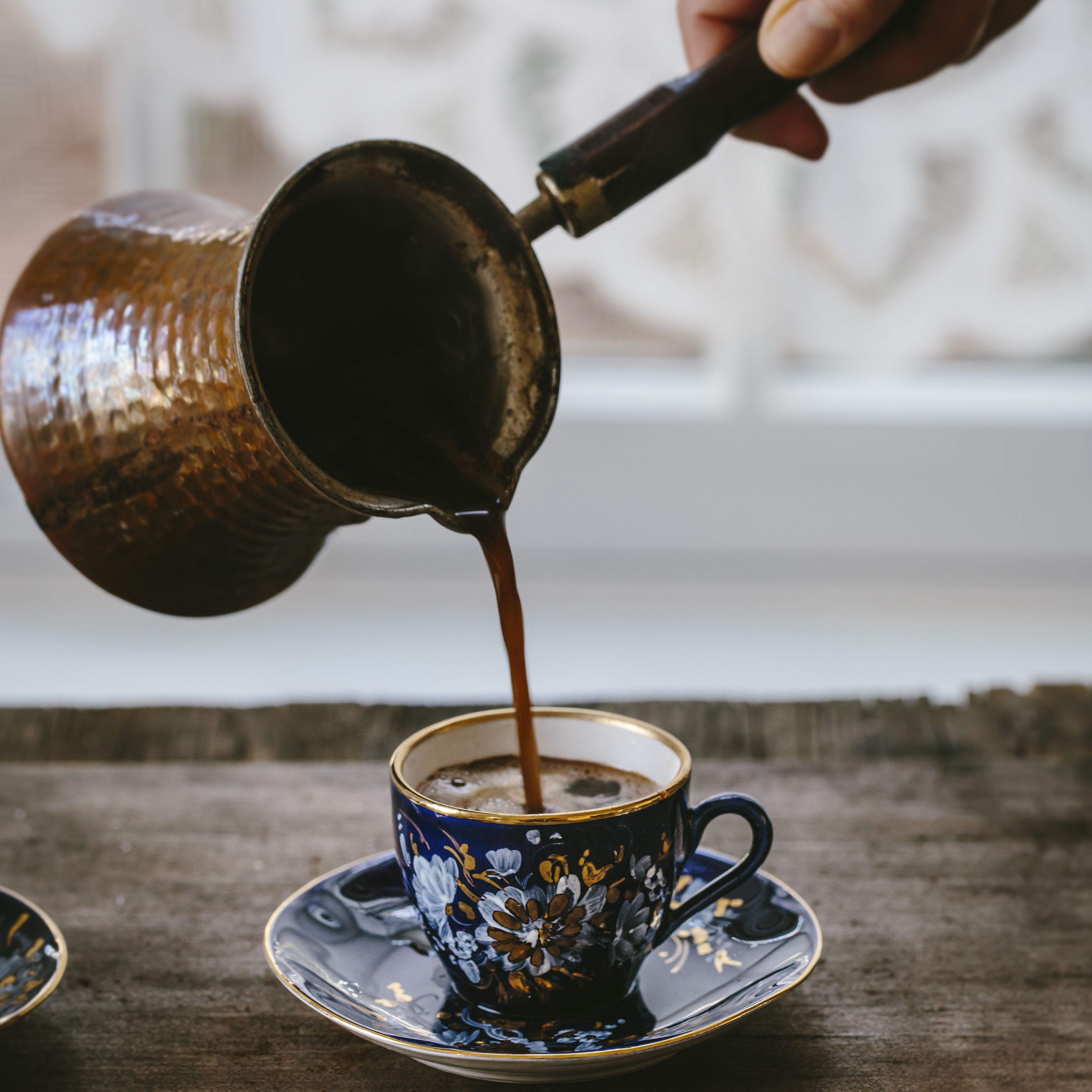 a-woman-is-pouring-turkish-coffee-in-to-a-vintage-turkish-coffee-cup-600103930-5825fe325f9b58d5b129c1a3